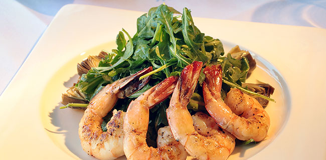 Arugula salad with artichoke hearts, grilled shrimp in a light olive oil and lemon dressing.